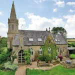 Church For Sale – Would you buy this: Three-bedroomed converted church goes up for sale complete with the original spire, altar, stained-glass windows… and GRAVES in the garden