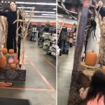 Little Girl Dances To Halloween Theme In Front Of Mike Myers Doll With Knife