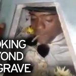 Bizarre moment murdered prisoner has 'SPLIFF' placed in his mouth in parting gift at funeral